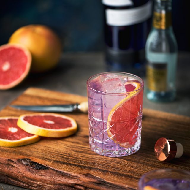 Purple gin and tonic with grapefruit